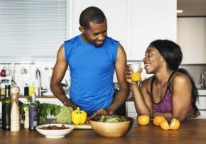 black-couple-cooking-healthy-food-in-the-kitchen-PR5K3XH (1)